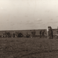 [Men and tractors in a field at Melfort Research Farm]