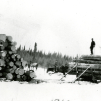 Decking logs [loading logs] 1949