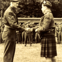 Cpl. LeRoy A. LeGrand accepting Military Medal from Lieutenant Colonel R. L. Rutherford