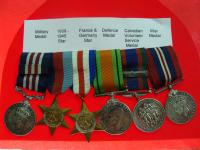 Cpl. LeRoy A. LeGrand's military decorations (front)
