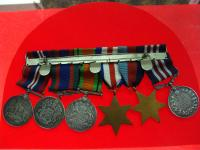 Cpl. LeRoy A. LeGrand's military decorations (back)