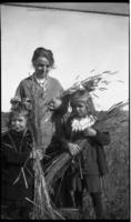 Woman and two children standing in a field near Borden
