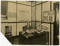 Realtor Udo Schrader at his desk
