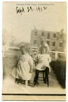 Leonora Schrader and Isabel Peterson in front yard of 321-6th Avenue North