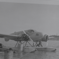 [Airplane on floats at a dock]