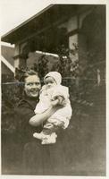 [Girl holding baby]