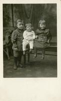 [Portrait of three children]