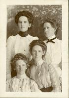 [Four women posing for camera]