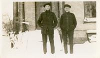 [Two men in front of building]
