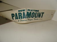 "Advertising board #1 - ""Now Playing Paramount - A Famous Players Theatre"""