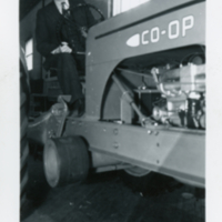 [Man in suit on Co-op tractor]