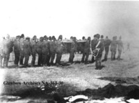 Burying the dead, during the Riel Rebellion.