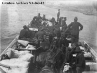 Horses and men on ferry crossing the North Saskatchewan River at Fort Carlton, Saskatchewan.