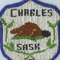 Charles Sask [hand-beaded badge]