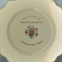 """Compliments of Hugh Stevenson Ltd. Shaunavon, Sask."" white china souvenir plate"