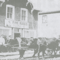 Oxen team 1920 - Louis Laplante in the wagon in front of Jarvis' Store. Seated left Jim McQue, center Ernie Jarvis