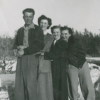 [Man and three woman in front of melting snow]