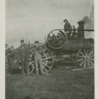 [Three men and a steam engine]