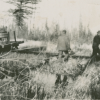 Nick and Fred Passmen stuck in the mud while hauling water on the road that is now between the two Reimers' places