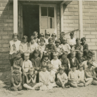 [Group of children in front of a school]