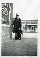[Women and child at street corner]