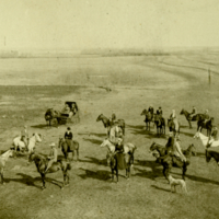 [Men and women on horseback with dogs]