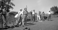 [Men and women lawn bowling]