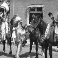 [Two Native men on horseback]