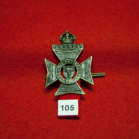 [Regina Regiment 105th Battalion cap badge]
