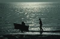 Silhouettes of boys on pier
