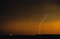 Grain elevator at sunset with lightning
