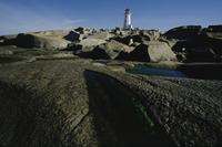 Lighthouse and rocks, morning light