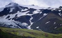Glacier and green hills of high country
