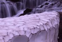 Melting snow patterns at waterfall