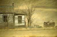 Dust storm, houses and tractor