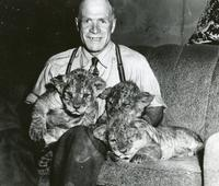"""Scotty"" McKenzie and Three Lion Cubs"