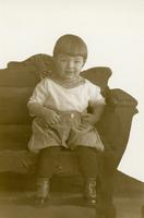 [Young child on carved chair]