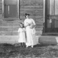 Mrs. Pittman holding Gertrude, with Gene beside her