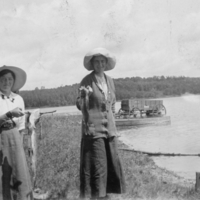 Two women holding fish at Kenosee Lake