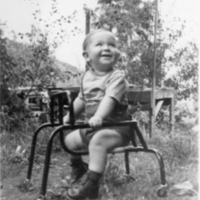 Child sitting in a chair