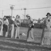 Central Collegiate girls preparing for a potato sack race