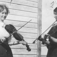 "Annie Nixon and Fret """"Trilly"""" Nixon playing the violin"