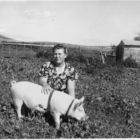 Emily Nicholson and her pig, Peggy Anne, on her parents' farm