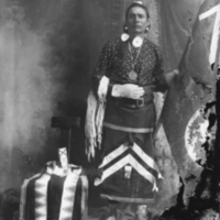 Aboriginal man standing wearing a medal