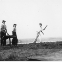 Four young men playing horseshoes