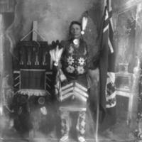 Aboriginal man with medicine-calling backrest banner