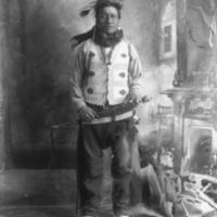 Aboriginal man with a coup stick