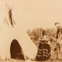 Aboriginal couple outside of a tipi