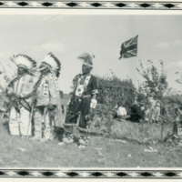 Three Aboriginal men in traditional dress