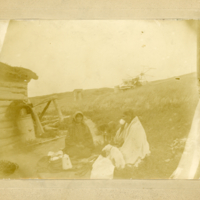 Aboriginal woman having tea by a sod shack
